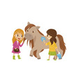 cute litlle girls taking care of they horse vector image vector image