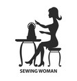 woman sitting with sewing machine vector image
