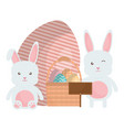 cute rabbits with easter eggs painted in basket vector image vector image