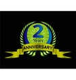 Green vintage anniversary message emblem 2 years vector image