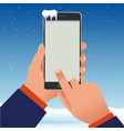 female hand is holding a phone outside vector image