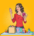 pop art woman wrapping cosmetics in gift box vector image vector image