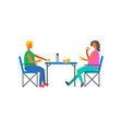 happy couple on picnic sitting on chairs at table vector image vector image