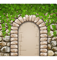 Stone wall with arch and leaves