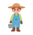 boy carrying a bucket water vector image