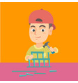 boy playing with toy constructor and hammer vector image vector image