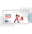 woman in santa claus costume pushing trolley cart vector image vector image