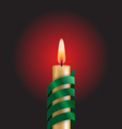Candle with green spiral tape on red vector image