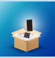 hand hold smartphone up from opening box vector image
