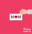 human hands holding mothers day card vector image vector image