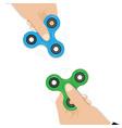 fidget spinners in hands popular fidget spinner vector image
