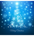 magic christmas tree with snowflakes on blue vector image
