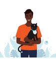 men holds his pet cat in his arms vector image