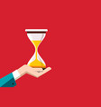 flat design hourglass in human hand on red vector image vector image