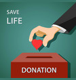 man puts a red heart in to donation box charity vector image