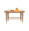 wooden table with two cups of tea cupcakes and vector image vector image