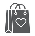 shopping bag with heart glyph icon love and vector image vector image