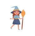 cute little girl dressed as a witch standing with vector image