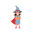 cute little girl dressed as a witch holding basket vector image vector image