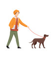 young man walking with dog in autumn casual vector image vector image