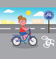 biker girl on bicycle lane vector image