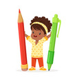 cute black little girl holding giant red pencil vector image vector image