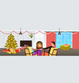 couple sitting near fireplace xmas new year winter vector image vector image
