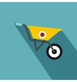 Yellow wheelbarrow icon flat style vector image vector image