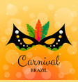 carnival mask with feathers on yellow background vector image