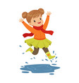 cute little girl playing on a puddle wearing vector image vector image