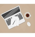 laptop and office supplies laying on brown vector image