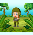 a soldier carrying a gun at the jungle vector image vector image