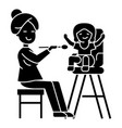 mother feeding child icon vector image vector image