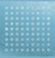 white snowflakes icon on blue background vector image