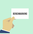 man showing paper benchmarking text vector image