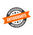 antioxidants sign antioxidants orange-black round vector image vector image