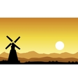 Silhouette of windmill on yellow sky vector image vector image