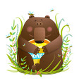 adorable bear cub eating sweet honey vector image vector image