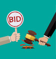 hands holding auction paddle and hammer vector image vector image
