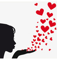 silhouette woman blowing heart vector image vector image