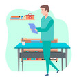doctor in medical office holding test vector image