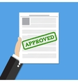 Hand holds approved document vector image vector image