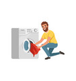 cheerful bearded man putting dirty clothes into vector image vector image