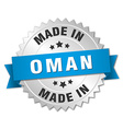 made in Oman silver badge with blue ribbon vector image vector image
