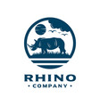 landscape rhinos in nature vector image