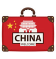 suitcase in colors of chinese flag vector image