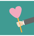 Businessman hand holding heart on stick vector image vector image