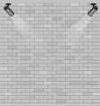 spotlights on grey brick wall background vector image vector image