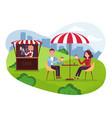 city park cafe with umbrella couple on weekend vector image vector image