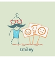 a man stands next to posters with smiles vector image vector image